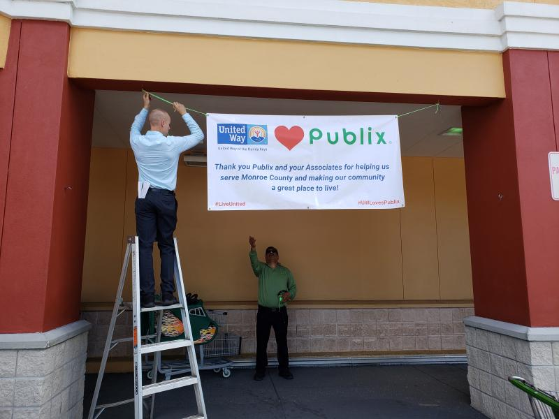 Two associates with a ladder helped us hang the banner.  Thanks guys!