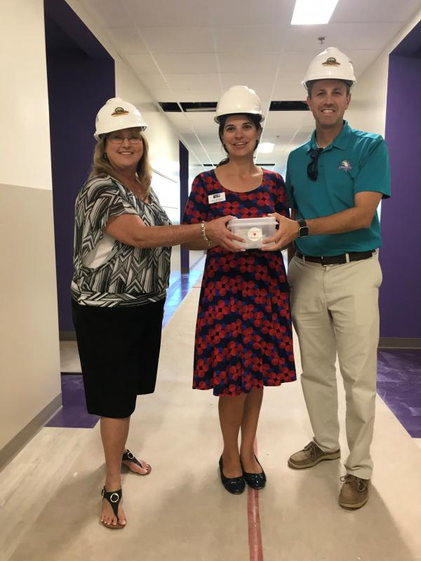 CEO Leah Stockton was given a tour of the Gerald Adams Elementary school currently under construction.  They plan to use the gift cards to furnish the new school.