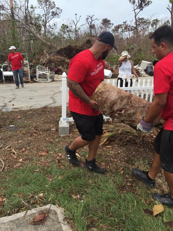 Wells Fargo employees worked hard doing debris removal and cleanup.