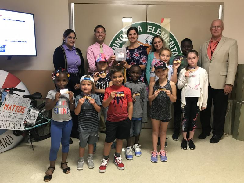 Publix Tools for Back to School gift cards are accepted by Poinciana Elementary staff and students and Superintendent Mark Porter.