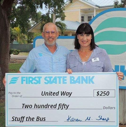 Jeff Smith from First State Bank presents their donation to UWFK Board Chair Maria Jones.  Thank you!