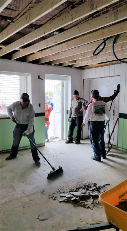 Workers repair Classroom 1 at Kreative Kids Academy, after their building was heavily damaged.