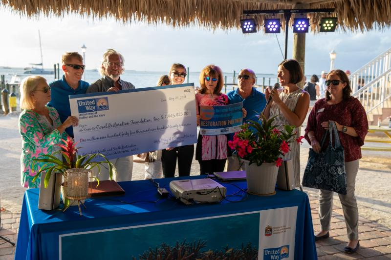 Keys Area President Leah Stockton of United Way of Collier and the Keys presents Coral Restoration Foundation board and staff with a check for $1,945,926 at Thursday evening's event in Key Largo. During the event, UWCK awarded over $2.1 million to support Mission: Iconic Reefs, one of the largest reef restoration efforts in the world.