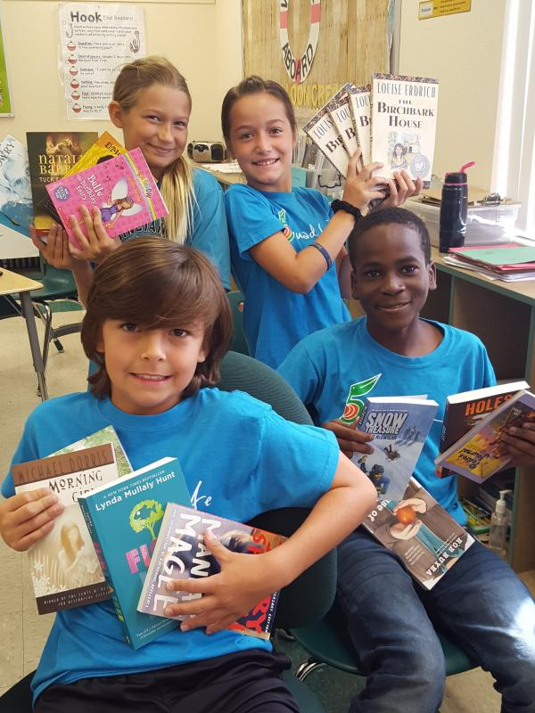 Ms. Van Loon's 5th grade class would like to thank the United Way for the opportunity to purchase high interest level books for our classroom library. This added much joy to the 5th graders at Poinciana Elementary!