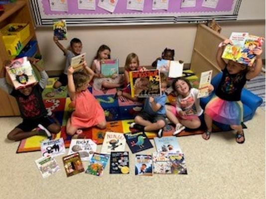New teachers at Poinciana were offered Stuff the Bus funds to help create their classroom libraries. The VPK students are excited about their new books.