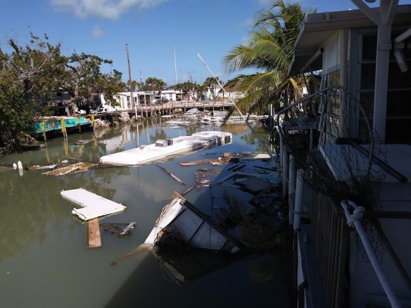 An RV sunk in one of the neighborhood canals is just a small part of the debris common in the Keys.  Canal cleanup began in June 2018 and continues still.